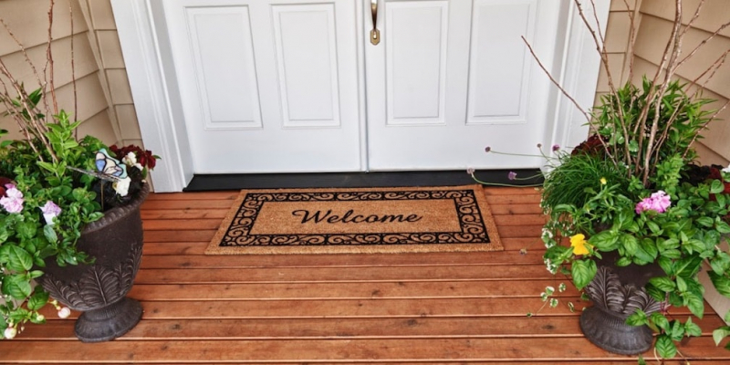 Welcome mat in front of door
